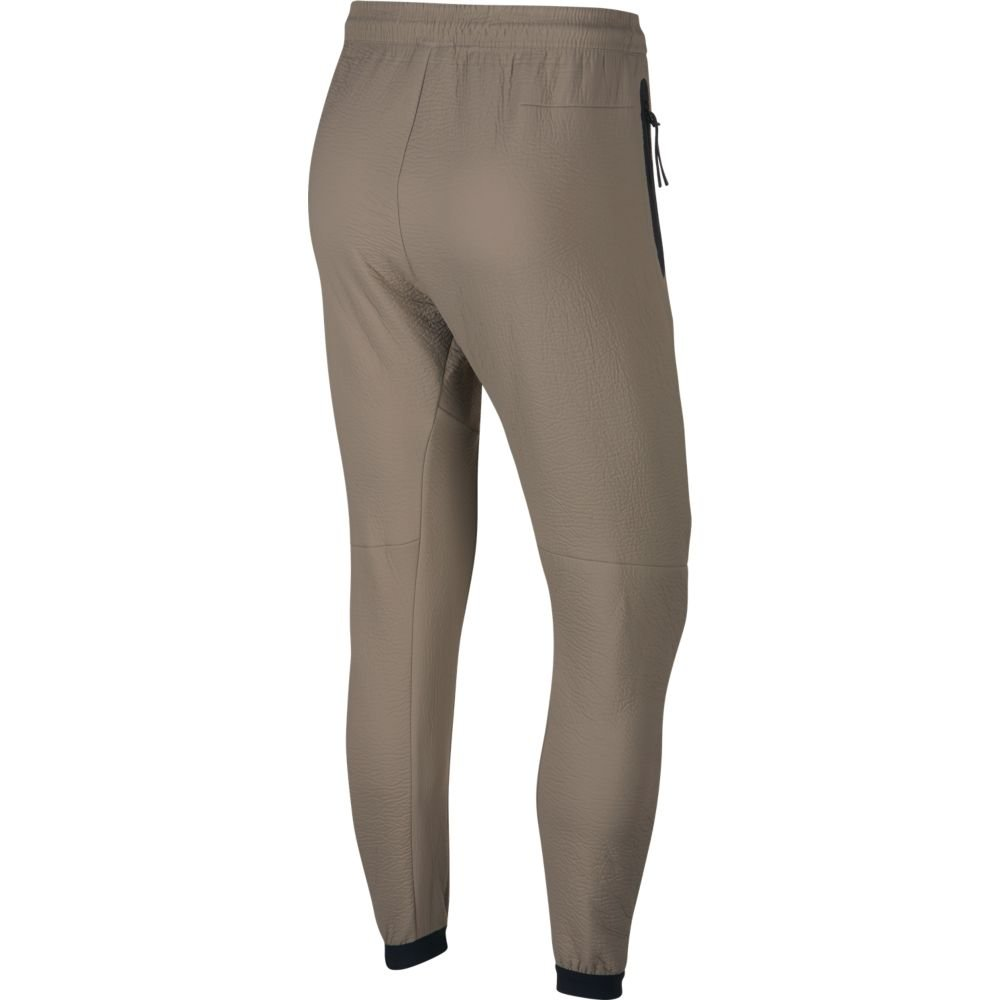 spodnie nike nsw tech pack pant track woven (928573-285)